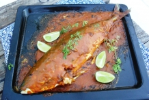 Yellowtail-fish-with-mushrooms,-green-peppercorns-and-lime
