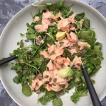Salmon, avocado, watercress and pumpkin seed salad